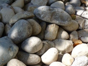 River stones are visually appealing, but still require maintenance