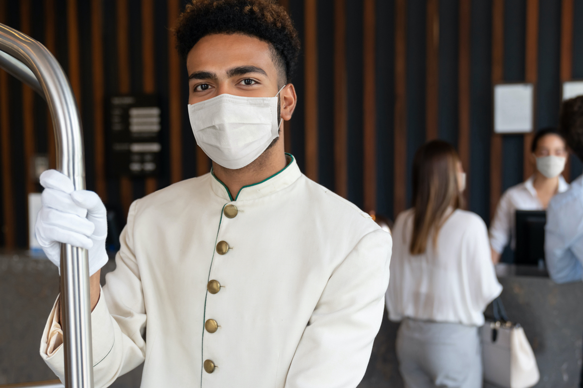 Bellman wearing mask and gloves at Marriott's hotel