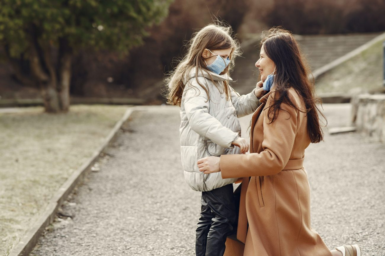 loving mother and daughter wearing medical masks and 4000613 scaled
