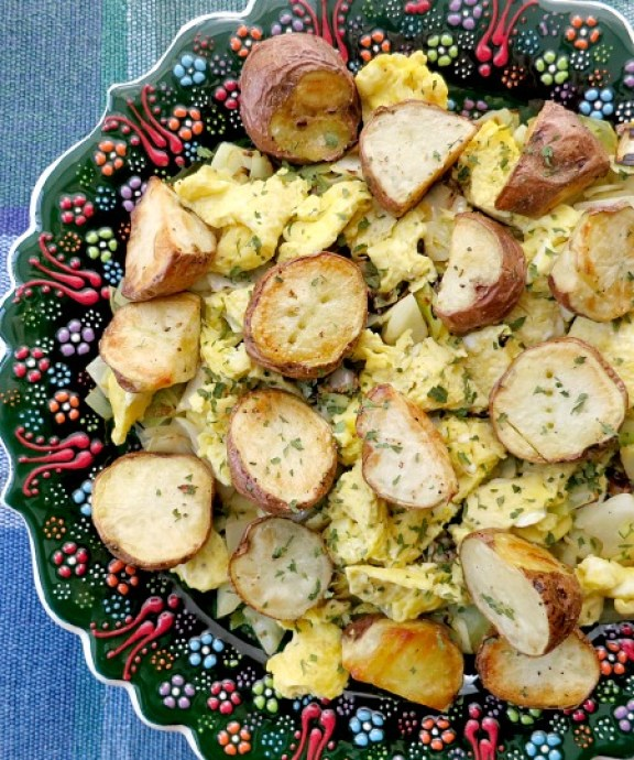 Breakfast Salad Sauteed Shallots and Cabbage, Scrambled Eggs and Red Skinned Potatoes