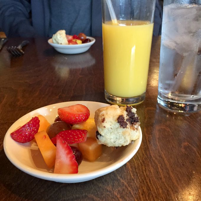 Fresh Fruit, Chocolate Chip Scone and OJ