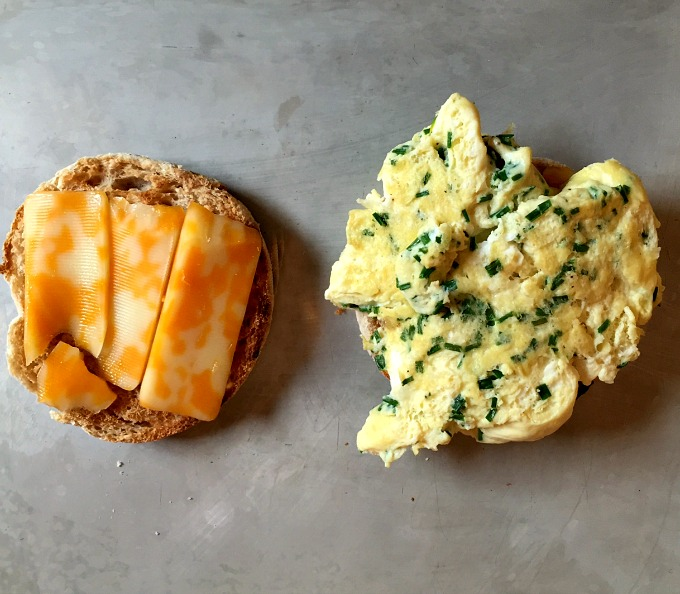 An easy cheesy egg sandwich. delicious for breakfast, lunch or dinner. It's the perfect way to get great and filling food in your face fast.