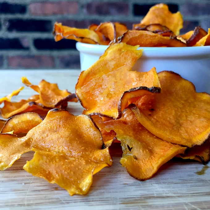 Crunchy sweet potato chips are baked low and slow in the oven and make a super satisfying and healthy snack.