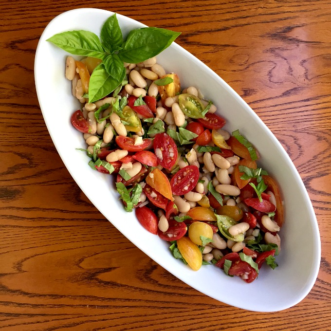 This salad is bursting with the bold flavors of summer: sweet, succulent tomatoes, brazen basil, gallant garlic and wholehearted white beans.