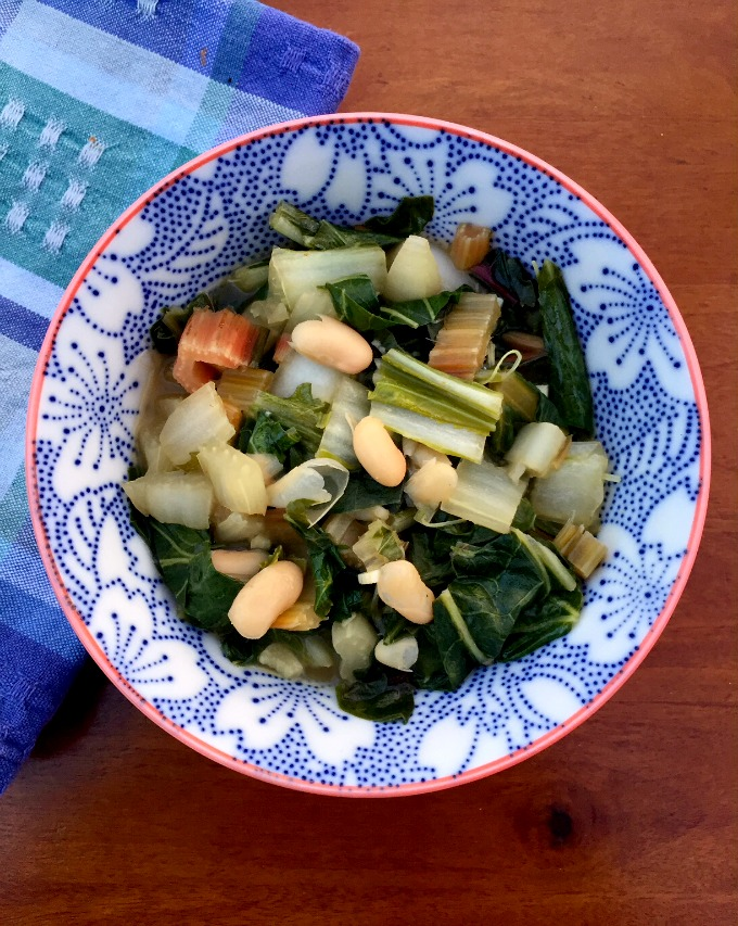 These cooked greens and beans are bursting with a gorgeous garlic flavor. They're easy to make and vegan to boot.