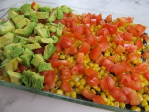 One Avocado Diced over Tomatoes for 7-Layer Bean Dip