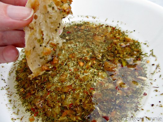 Toasted Garlic Olive Oil Bread Dip on Piece of Bread
