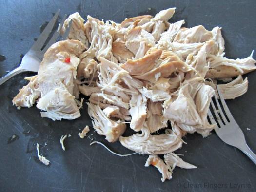 Copycat Cafe Rio Chicken Shredded on Cutting Board