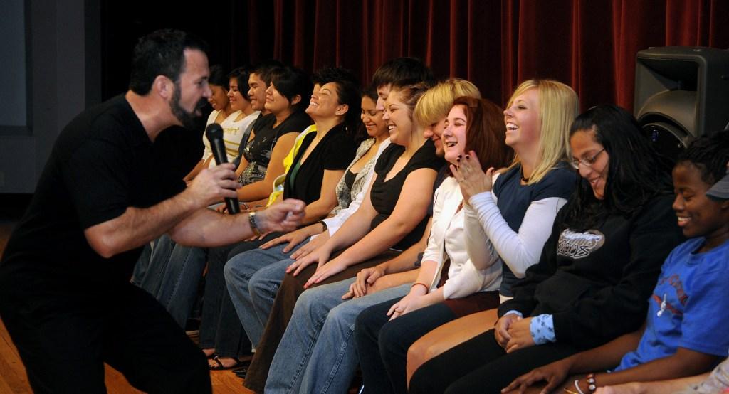 comedy stage hypnotist William Mitchell entertaining a crowd
