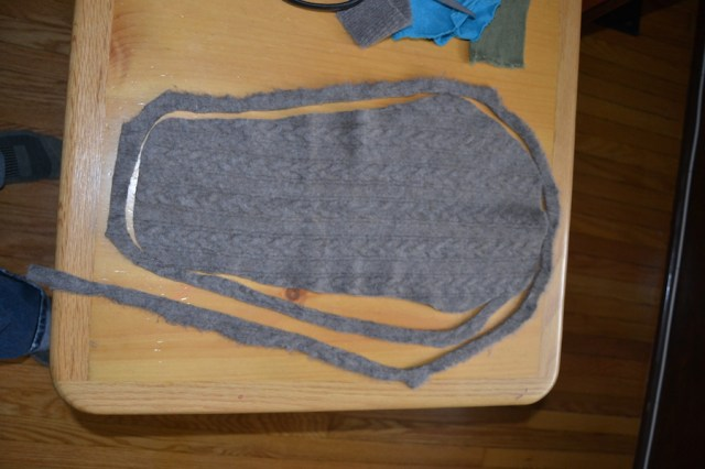 Cut your wool piece into one long strip.