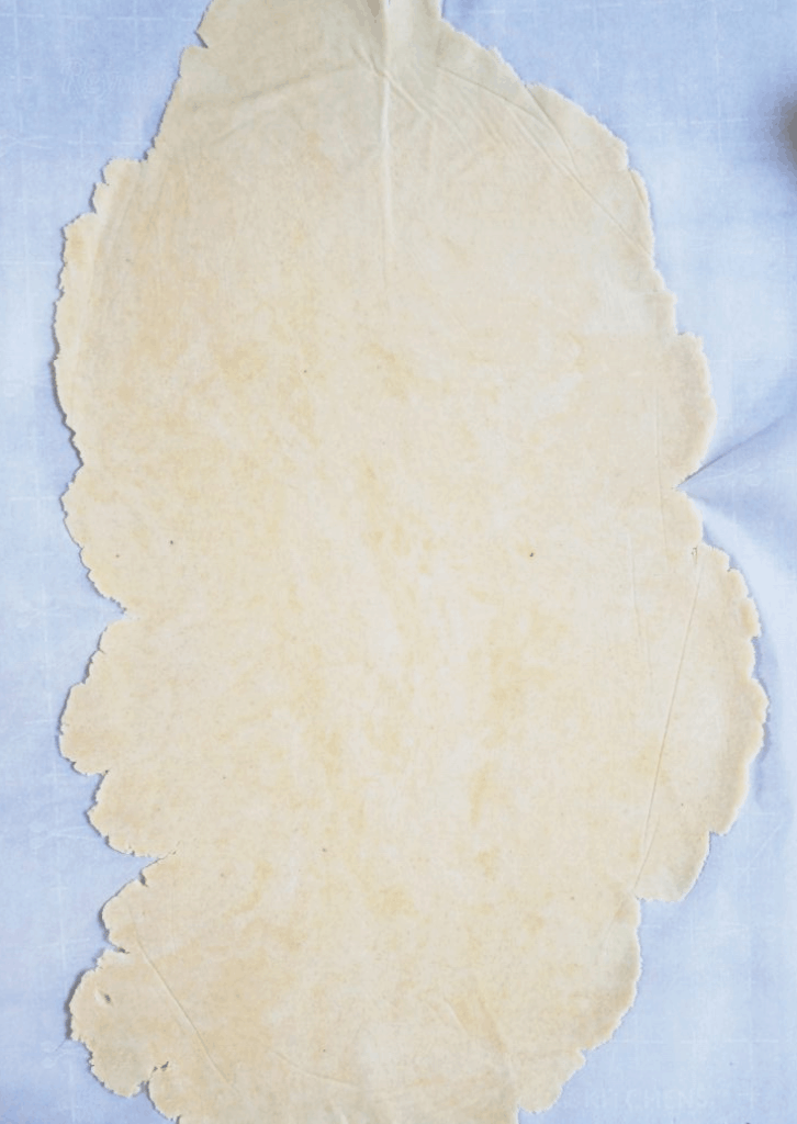 rolled out dough on parchment paper