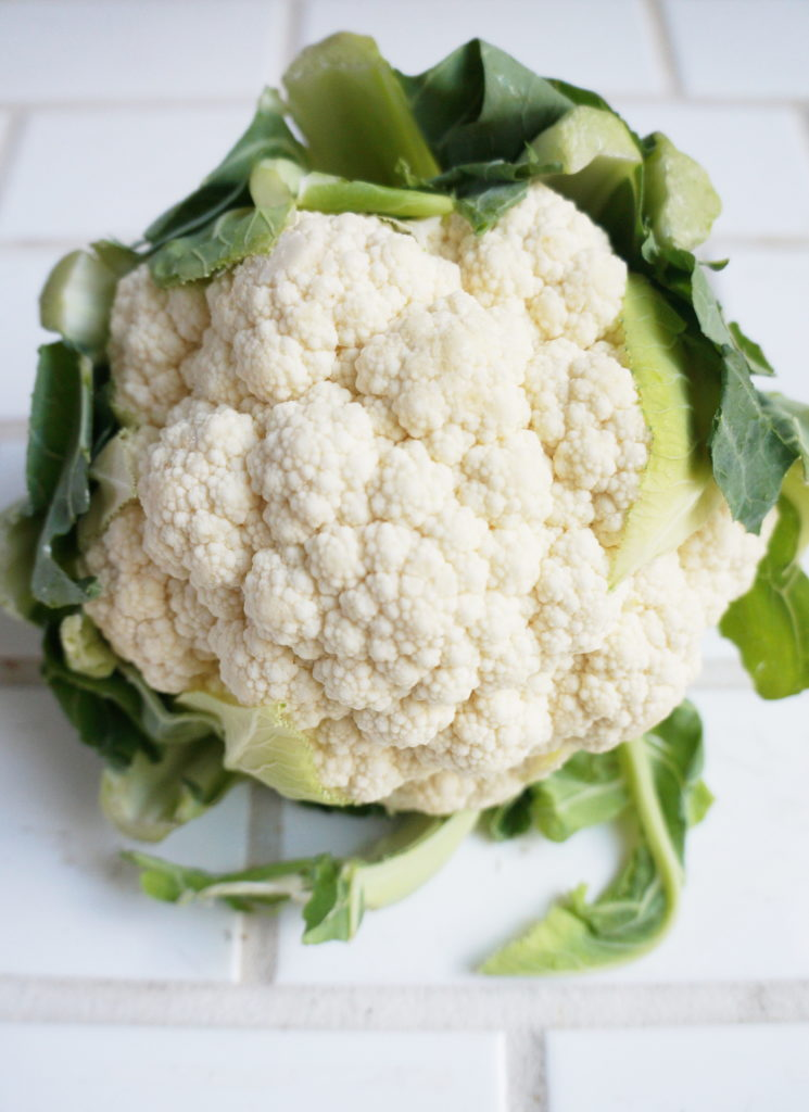 Cauliflower Head with Green Leaves