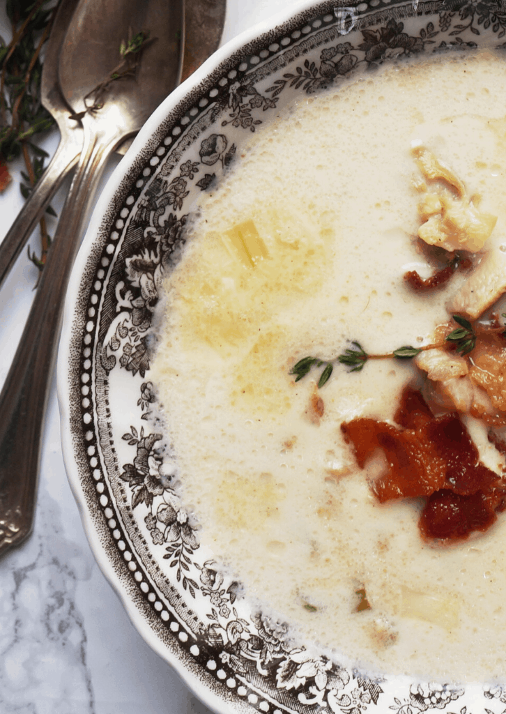 Keto Clam Chowder in a bowl with bacon on top