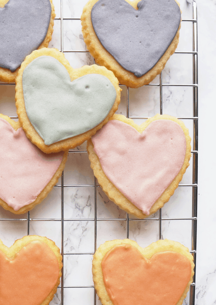 Keto Sugar Cookies shaped as hearts on a wire rack