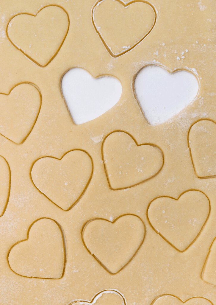 Cookie dough with hearts cut out