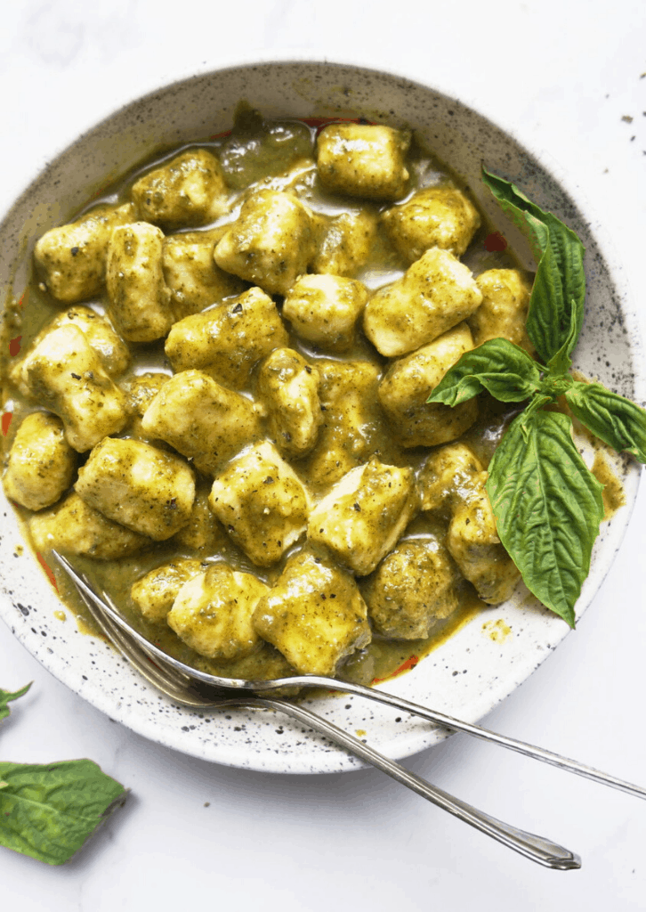 Keto Gnocchi with pesto in a white bowl
