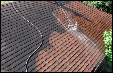 Pressure washing and cleaning the roof