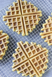 Overhead view of pumpkin waffles on a wire cooling rack