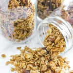 side view of honey granola in tipped over mason jar