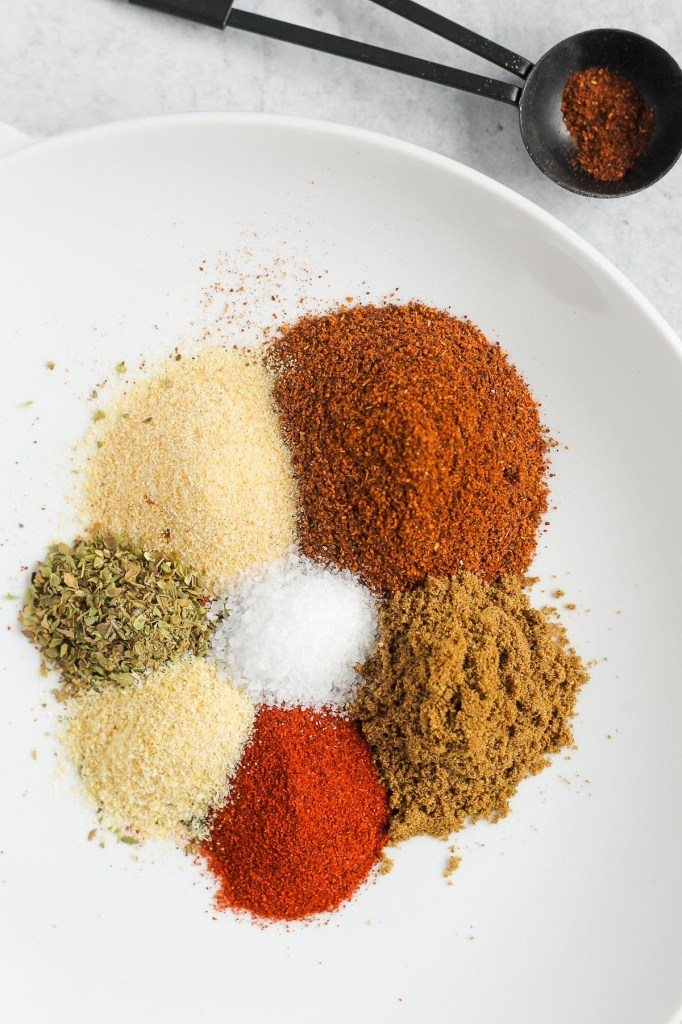 overhead view of seasoning ingredients piled on a white plate