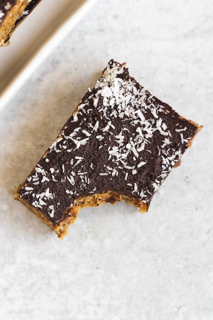overhead view of single no bake peanut butter bar with bit taken out of the corner
