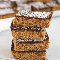 side view of stacked no bake peanut butter bars