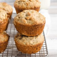 side view of banana muffins stacked two high on a wire cooling rack
