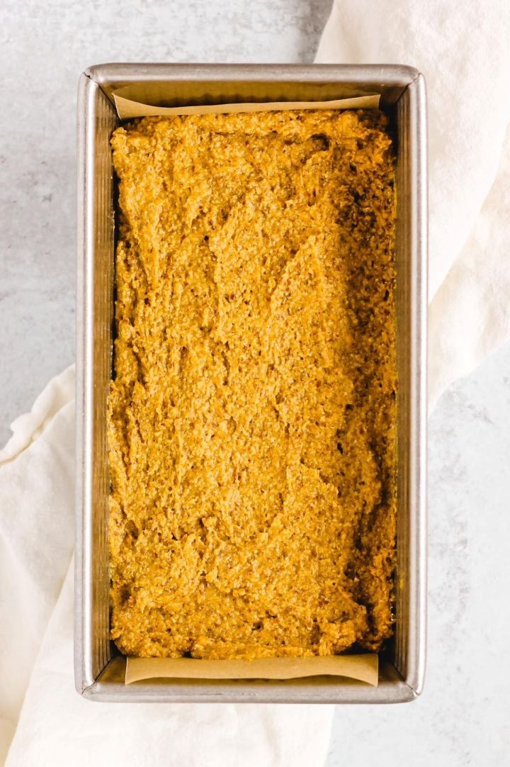 overhead view of the pumpkin batter in loaf pan before baking