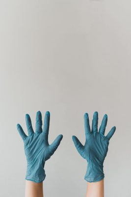 Someone with cleaning gloves on