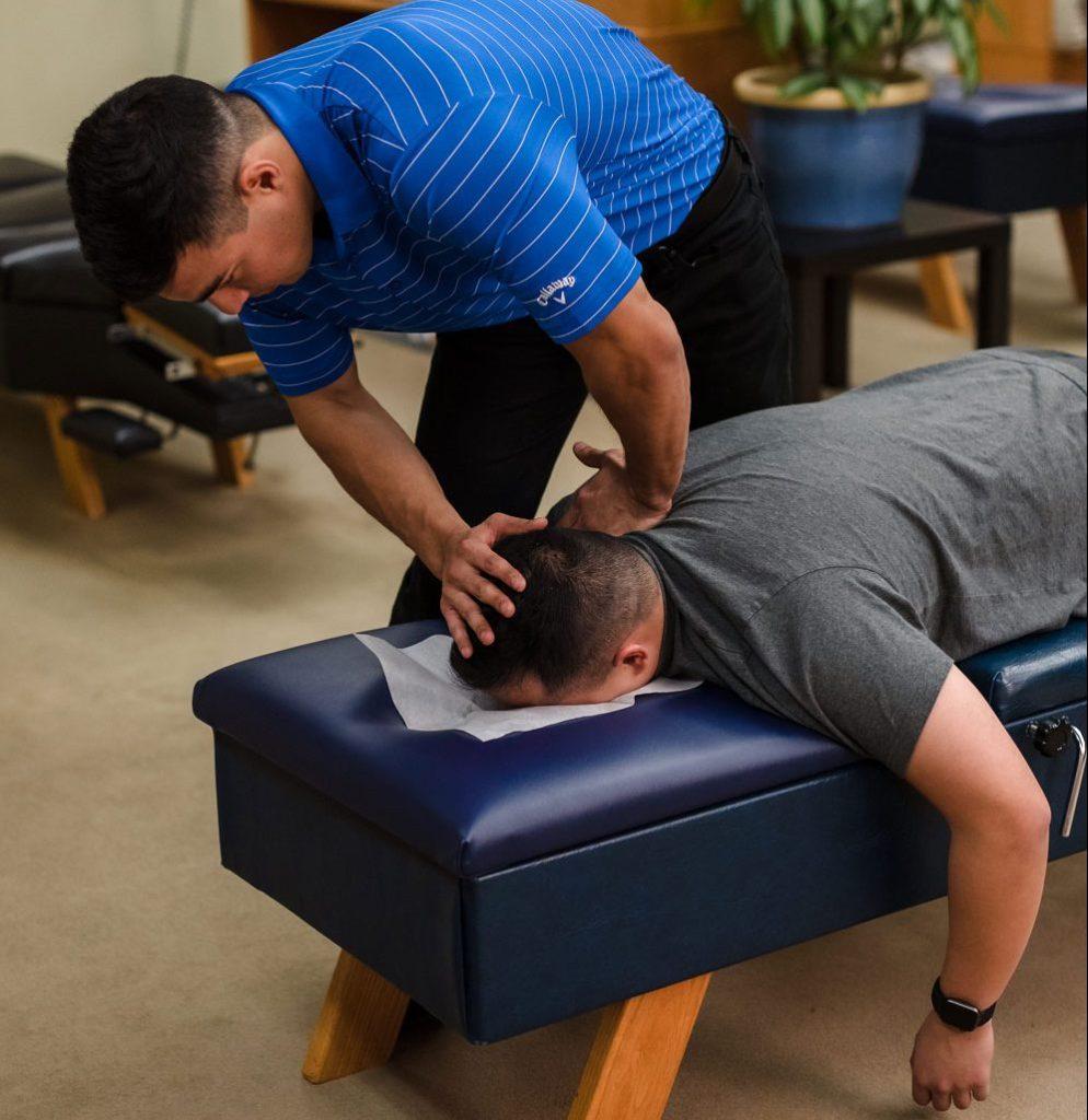 Dr. Tyler Bigenho - Chiropractic Adjustment