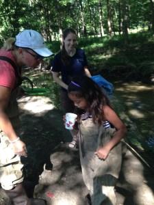 Monica Billger demonstrating Creek Critters app to children