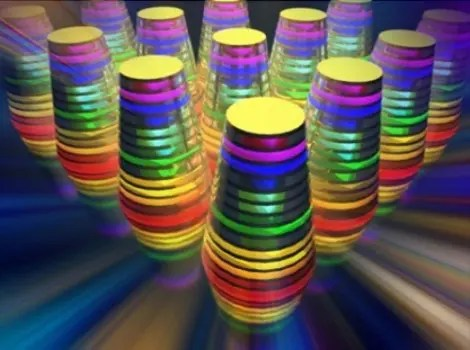 """The image shows a """"multilayered waveguide taper array."""" The different wavelengths, or colors, are absorbed by the waveguide tapers (thimble-shaped structures) that together form an array. Image Credit: University at Buffalo"""