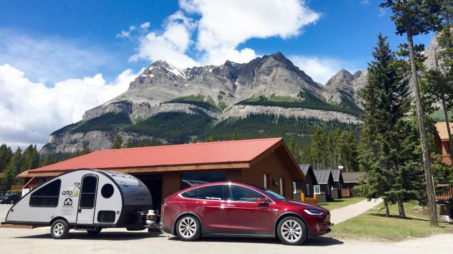 Tesla Model X towing a camper