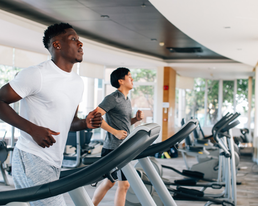 Disinfect your gym with Clear Gear Spray - Man working out at gym