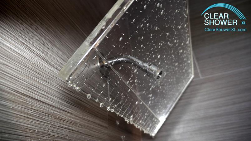 Large Clear rain showerhead in grey bathroom