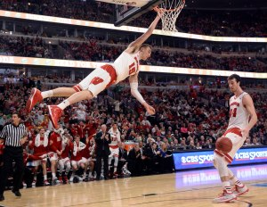 Mar 14, 2015; Chicago, IL, USA; Wisconsin Badgers forward Sam Dekker (15) hangs onto the rim after dunking the ball against the Purdue Boilermakers during the second half in the semifinals of the Big Ten Tournament at United Center. Mandatory Credit: David Banks-USA TODAY Sports