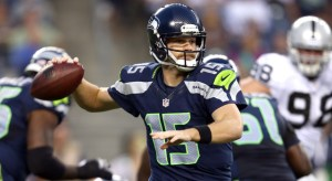 Seattle Seahawks quarterback Matt Flynn (15) gets ready to throw in an NFL preseason football game against the Oakland Raiders, in Seattle, Washington Thursday, Aug. 30, 2012. (AP Photo/Tom Hauck)