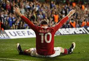 Manchester United's Wayne Rooney celebrates after scoring a goal during the first leg of their Champions League quarter final soccer match against Chelsea at Stamford Bridge in London April 6, 2011. REUTERS/Dylan Martinez   (BRITAIN - Tags: SPORT SOCCER)