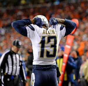 San Diego Chargers wide receiver Keen Allen (13) points to his name of the back of his jersey after making a 16-yard touchdown catch during an AFC Divisional Playoff game against the Denver Broncos on Sunday, Jan. 12, 2014, in Denver. The Broncos won the game, 24-17. (AP Photo/Greg Trott)