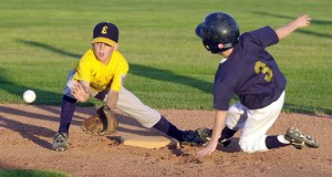 Snow Canyon's Blake Ovard steals second base while Enterprise shortstop Tanner Laub waits for the throw to make the tag during the Utah State Little League Tournament Thursday, July 13, 2001. (Photo by Jud Burkett)