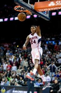 Atlanta Hawks guard Kent Bazemore scores. (AP Photo/John Bazemore)