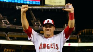 Jul 15, 2014; Minneapolis, MN, USA; American League outfielder Mike Trout (27) of the Los Angeles Angels holds up the MVP trophy after after the 2014 MLB All Star Game at Target Field. Mandatory Credit: Scott Rovak-USA TODAY Sports
