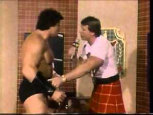 "Piper questions ""Iron Mike"" Sharpe about his forearm brace on Piper's Pit."