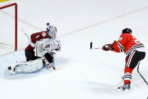 A breakaway shot by Chicago Blackhawks right wing Ben Smith (28) sails over Colorado Avalanche goalie Semyon Varlamov and the net during the first period of an NHL hockey game, Tuesday, Jan. 14, 2014, in Chicago. (AP Photo/Charles Rex Arbogast) ORG XMIT: CXA106