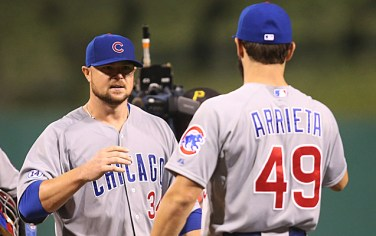 Sep 15, 2015; Pittsburgh, PA, USA; Chicago Cubs starting pitcher Jon Lester (34) celebrates with pitcher Jake Arrieta (49) after a complete game against the Pittsburgh Pirates at PNC Park. The Cubs won 2-1. Mandatory Credit: Charles LeClaire-USA TODAY Sports