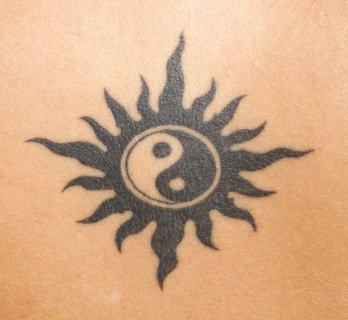 Yin and Yang and the sun and a tatoo