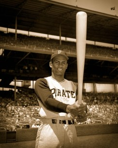 Roberto Clemente shows off his bat at Forbes Field.