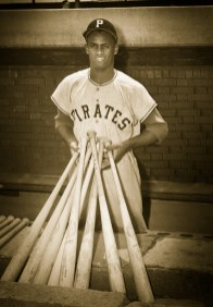 Roberto Clemente displays a collection of bats.