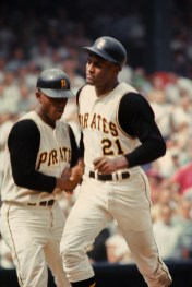 Roberto Clemente jogs past his teammate shows a moment of solidarity.
