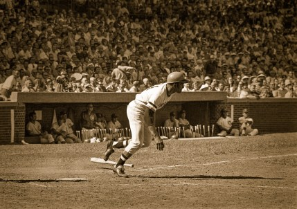 Roberto Clemente heads for first after a hit. Wrigley Field 1972
